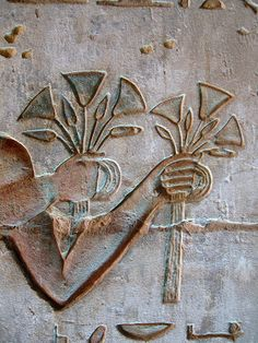 A bouquet in each hand... Ancient Egyptian carving