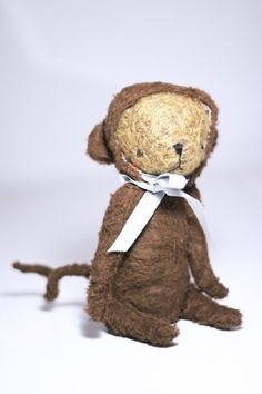 Thomas the jointed mohair bear in a monkey suit.