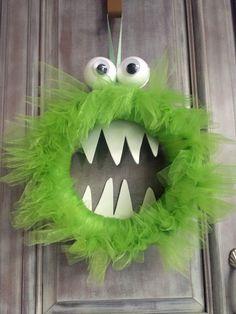 A Monster Wreath I made from Styrofoam form, tulle, Styrofoam balls & wiggle eyes & white foam sheet for the teeth.