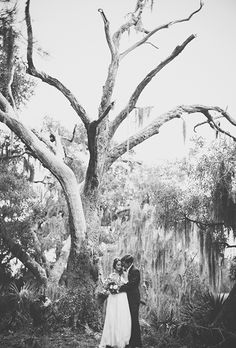 Brides.com: The Best Real Wedding Photos of 2015 Cathleen and Joseph's boho-chic South Carolina wedding was held at one of the dreamiest properties we saw this year. So it's no surprise that their photographer had the chance to capture this magical shot as the couple shared a quiet moment beneath trees dripping with Spanish moss.Photo: Studio Mynt