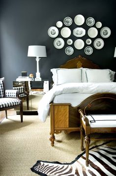 Courtney Giles: a bold bedroom design with black walls, antique wood bed and… Hotel Bed, Dark Walls, Grey Walls, Wood Beds, Plates On Wall, Plate Wall, Hanging Plates, Paint Plates, How To Antique Wood