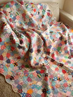 Scrappy applecore quilt.
