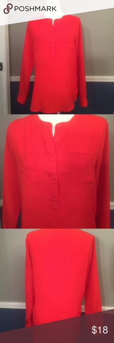 The perfect Red Blouse Wowzers is this a gorgeous shirt! Long sleeve red blouse, with front pockets. Very simple, but stunning with a pair of black pants/jeans!! Tops Blouses