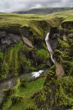 The Fjaðrárgljúfur Canyon in Iceland, a natural wonder created by the water from the glaciers. Its waterfalls and cliffs offer breathtaking views we cannot miss. Try a hike and do your best with a camera.
