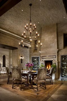 Gorgeous dining room with brick walls, fire place and wine storage.