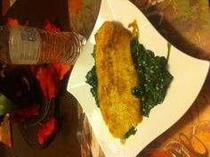 I love good eatin!!!! Pan seared Talapia over a bed of sautéed spinach!!!