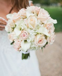 Bridal bouquet of roses calla lilies romanticism