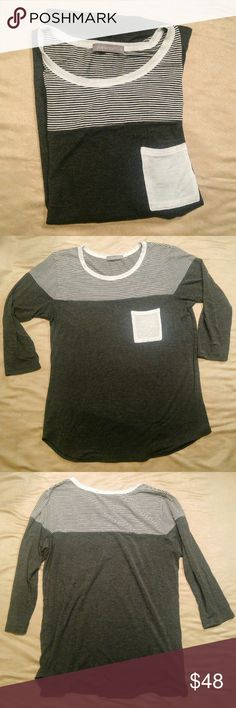 Loveappella Edgewater Knit Top Soft and stylish! The color blocked top and pocket are super cute! Goes great with leggings!   Large.   95% Rayon, 5% Spandex  From Stitch Fix! This was in one of my favorite Stitchfix boxes. It just doesn't fit anymore.  Always washed on delicate and laid flat to dry. In perfect condition. No rips, stains or holes. Loveappella Tops Tees - Long Sleeve