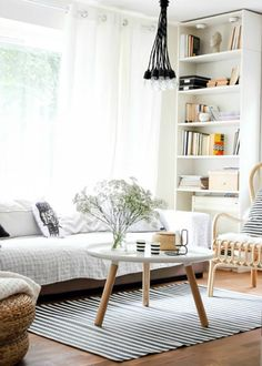 Simple airy black and white living room - 15 Oh-So-Chic Black and White Interiors| via Brit + Co.