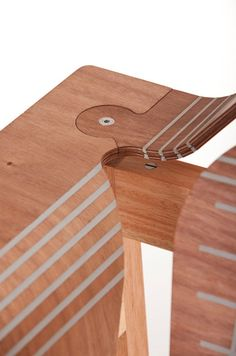 A newer design technology in the Wintec Innovation fold (see our post on their Winbloks) is their Stratflex system. It's essentially flatpack furniture with a twist, or rather, a bend: Plywood is scored through several of its layers at specific junctures, allowing the forms to ship flat, but flex during assembly. The gaps are permanently filled with a flexible polymer that can withstand the slight deformation.