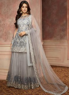 Grey Embroidered Net Lehenga features a net kameez with santoon inner, net lehenga with santoon inner and net dupatta. Embroidery work is completed with thread and stone embellishments. Indian Bridal Lehenga, Pakistani Bridal Dresses, Indian Dresses, Pakistani Outfits, Party Wear Lehenga, Party Wear Dresses, Wedding Dresses, Lehenga Choli Online, Net Lehenga