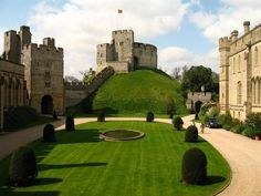 Arundel Castle England - this was so much fun, you can see it in different centuries, the original being on top of the mound.  Beautiful gardens and there is a family that still lives there (Duke) they fly the flag when they are in residence.