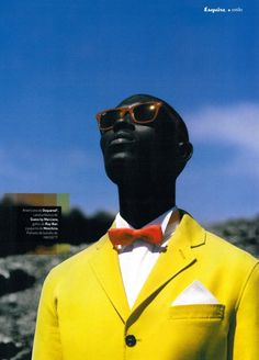 Love this.  This guy's beautiful ultra black skin against the blue sky with his yellow jacket. Outstanding.