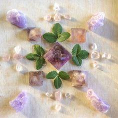 Beautiful Crystal Mandala ~ Ametrine, Super Seven, Amethyst, Danburite with Wild Strawberry leaves. Crystal Magic, Crystal Grid, Crystal Healing, Crystal Mandala, Crystal Flower, Crystals And Gemstones, Stones And Crystals, Strawberry Leaves, Wild Strawberries