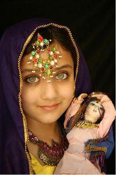 afghan girl and doll