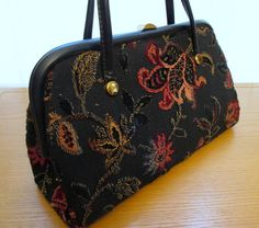 """Vintage Tapestry Handbag, 1960s, Carpet Bag, Verdi Tapestry Purse, chenille fabric, black flower bag, pink floral, velour bag, tapestry bag // fabulous, roomy + beautifully made vintage Verdi black tapestry handbag with gorgeous cut work chenille velour flowers that feel great to touch // lined in beige vinyl with an inside zippered pocket //  timeless, classic style + gorgeous for that office groove // Size - 13"""" wide x 7"""" tall x 4"""" wide at bottom"""