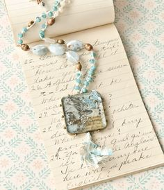 Stephanie Gard Buss creates miniature collages set in resin inside Jewelry Affaire.