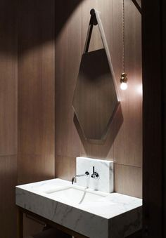 a swank wood-panel-clad powder room, located in the same Melbourne, Australia home as the media room shown above. Design by Kerry Phelan Design Office and Chamberlain Javens Architects. Photo by Derek Swalwell.