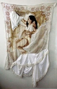 '8 months' - hand embroidered, appliquéd and stained on re-appropriated linen, 44 x 85 in. Joetta Maue.
