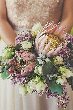 Pink Protea Wedding Bouquet via jenna henderson / http://www.himisspuff.com/fall-wedding-bouquets-for-autumn-brides/8/