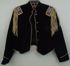 """Black Leather Western Style Jacket With Tan Trim -Size XL by PHOENIX USA FRONTIER COLLETION -Pigsplit Leather and acetate blend -Tassels and Aztec beaded design  -Width 40""""/Length 22"""" -Well made, beautiful, and stylish -"""