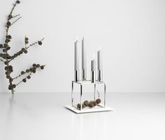 3rd Sunday of advent celebrated with three lit candles in by Lassen's nickel.plated Kubus 4, designed by Mogens Lassen in 1962.
