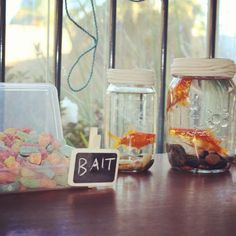 "Gone fishing theme party decorations @Candice Erickson Simonson We can put a sign that says ""Bait"" and have candy jars with gummy worms and fish?"