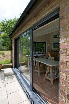 large aluminium sliding doors in grey.