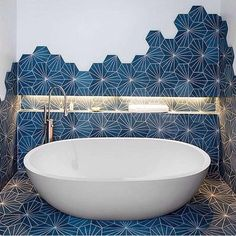 Love the tile creeping up the wall!!! Maybe for the kids bath someday, but I had to toss it in here.