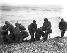 D-Day: The Normandy Invasion. Members of a landing party help injured Soldiers to safety on Utah Beach during the Allied Invasion of Europe on D-Day, June 6, 1944. www.army.mil/d-day