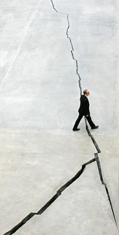"""Doris Salcedo, 2007, Shibboleth. Artist's statement: """"It represents borders, the experience of immigrants, the experience of segregation, the experience of racial hatred. It is the experience of a Third World person coming into the heart of Europe. For example, the space which illegal immigrants occupy is a negative space. And so this piece is a negative space."""" Quoted from Wiki"""
