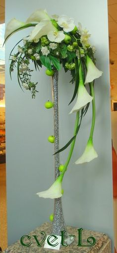 Discover thousands of images about Pure and Simple - A modern tall container arrangement featuring white Calla Lilies, white Anthurium and Chrysanthemums Contemporary Flower Arrangements, Creative Flower Arrangements, Church Flower Arrangements, Beautiful Flower Arrangements, Beautiful Flowers, Altar Flowers, Church Flowers, Funeral Flowers, Wedding Flowers