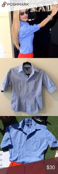 Ralph Lauren Slim Fit Button Down Fitted to the female form with darts in front and back to give a slim fitted look.  This light blue and white strip shirt also has button sleeves to add feminine detail to the arms. Great staple for any wardrobe and very versatile! Ralph Lauren Tops Button Down Shirts
