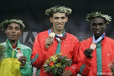 Winners podium of the mens metres final at the Athens 2004 Olympic Games. - Buy this stock photo and explore similar images at Adobe Stock 2004 Olympics, Track And Field, Olympic Games, Athens, Finals, Adobe, Stock Photos, Explore, Men