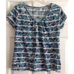 Pleated V-Neck Tee Pretty v-neck tee by LOFT with subtle pleating at the neckline. All over turquoise, navy and lavender floral pattern broken by white stripes. Worn only a few times. LOFT Tops