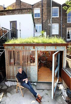 Marcus Shields, from Kentish Town, who has been awarded winner of the Eco shed category in the 2013 Shed of the Year competition sponsored by Cuprinol for his eco bike house shed