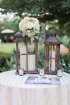 My boyfriend and I both have family dearest to us that will not have been able to physically be with us on our wedding day so it is important to the both of us to have a table set up at our ceremony and celebration in memory of those not with us. I want lanterns much like these, maybe painted silver with pictures of our family members not present in beautiful frames and candles lit for them on my wedding day. You can find lanterns like these at Micheal's.