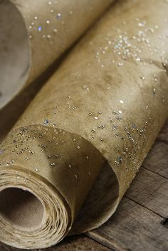 "Galaxy Paper 20"" x 16.5 ft. Gold Paper Roll - We used this at the bar under the drinks. It really catches the light and sparkles great. End of the night, you just toss it. It was perfect!"