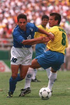 "Roberto Baggio (Italy, 1988–2004, 56 caps, 27 goals) and ""Dunga"" Carlos Caetano Bledorn Verri (Brazil, 1987–1998, 91 caps, 6 goals). 1994 FIFA World Cup Final at the Rose Bowl, Pasadena, USA on 17 July 1994. Brazil vs Italy 0-0 (after extra-time), penalties 3-2."