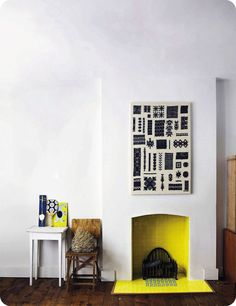 Yellow tiles add a pop of colour in this fireplace.