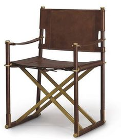 The Alexander Arm Chair by Palecek Stainless steel frame wrapped with cowhide leather. Seat, back and arms in cowhide leather. Rattan cane matting on outside back panel. Brass accents and rivets. Available only as shown