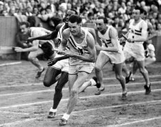 America's Harrison Dillard, second left, hands over the baton to Melvin Patton, third left, for the final leg of the men's Olympic Games 4 x 100metres Relay Final at Wembley Stadium, London, Aug. 7, 1948, to win the race. Britain's John Archer, second right, came in second. The American team were disqualified for a wrong baton change. (AP Photo)