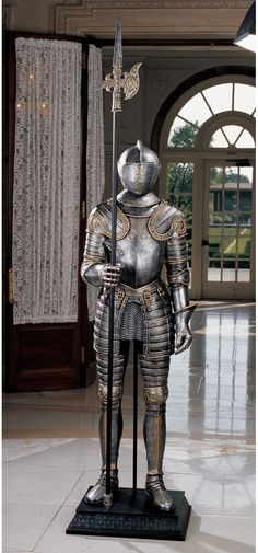 Features:  -Hand painted.  -Faux chain mail, faux leather strapping, and hinged helmet.  Product Type: -Statue.  Style: -Traditional.  Theme: -Historic.  Subject: -People.  Finish: -Silver; Brass.  Pr