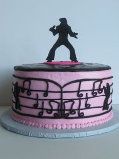 Elvis cake - Elvis birthday cake covered in buttercream with fondant accents and gumpaste Elvis silhouette covered in black disco dust on top of cake.