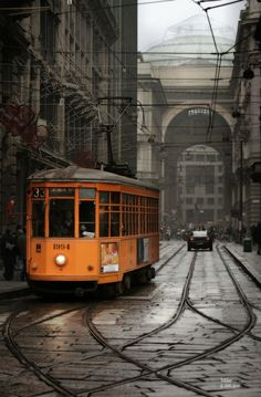 Photo of an orange tram in Milano, Italy. Photo by G. Little, 2006. #italyphotography