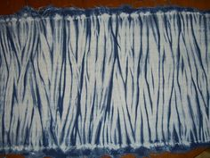 Fabric was stitched to the circumference of the pole then scrunched down without any string. Indigo on cotton/linen
