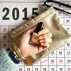 Grey September days aks for bright nails! Love this orange shade from @pronails_hq ⬜️⚫️ #fw15 #nailpolish #pronails #brightupyourday #fluffycardigan #orangenails #woutersenhendrix #goldjewelry #accessories #roseclutch