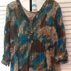 SHEER V NECK SMALL RUFFLE COLLAR/CUFF TOP Teal, sheer top with 3/4sleeve. That has elastic small ruffle neck and sleeves. Has high waist. 4 buttons down front. Polyester MW Notations Tops Blouses