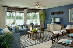 The living room in The Skyview model in Panama City Beach. Love the blue color for the walls and furniture and the neutral floors.