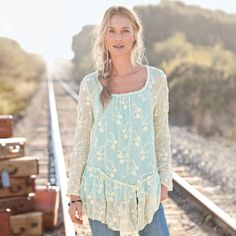 "FLORAL VEIL PEPLUM TUNIC -- Flower-embroidered ivory silk chiffon veils a sky blue camisole. A gently gathered peplum dips to the slit hem, tatting rims the neck and sleeves. Dry clean. Imported. Exclusive. Sizes XS (2), S (4 to 6), M (8 to 10), L (12 to 14), XL (16). Approx. 27-1/4""L."